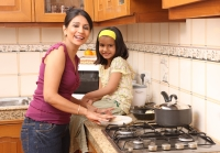 Mother and daughter in kitchen - Deepak Budhraja
