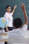 teacher at chalkboard, boy raises hand - Alex Mares-Manton