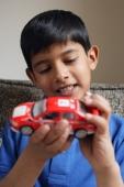 boy holding red car (vertical) - Alex Mares-Manton
