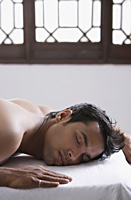 young man on massage table - Alex Mares-Manton
