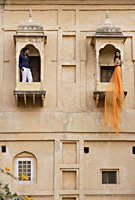 man and women on balconies, woman in sari - Alex Mares-Manton