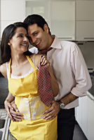 young couple sharing special moment in kitchen - Alex Mares-Manton