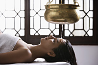 young woman having Ayurvedic spa treatment - Alex Mares-Manton