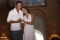 couple wearing white, embracing - Vivek Sharma