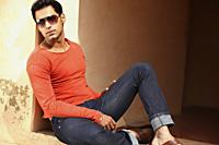 man reclining in sunshine - Vivek Sharma