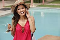 woman at resort, on phone - Vivek Sharma