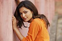 woman leaning against a wall - Vivek Sharma