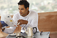 man reading newspaper - Vivek Sharma