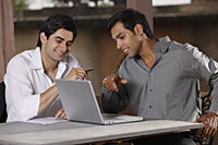men working at laptop computer - Vivek Sharma