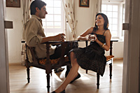 couple in room, having hot drink - Vivek Sharma