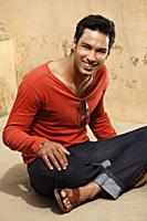 man sitting in sunshine - Vivek Sharma