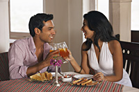 couple toasting in cafe - Vivek Sharma