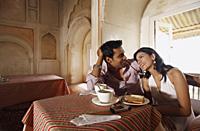 couple having coffee, chatting - Vivek Sharma