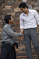 men shaking hands - Vivek Sharma