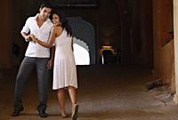 couple wearing white, smiling - Vivek Sharma