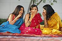 three women in saris, gossiping - Vivek Sharma