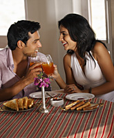 couple at restaurant, toasting - Vivek Sharma