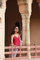 woman looking off balcony - Vivek Sharma