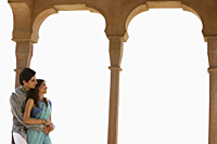 young couple, archway of traditional Indian building - Alex Mares-Manton