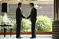 businessmen shaking hands - Alex Mares-Manton