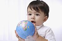 baby boy holding globe - Alex Mares-Manton