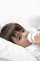baby boy drinking from bottle - Alex Mares-Manton