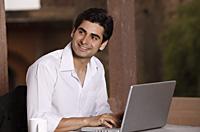 man working at laptop computer - Vivek Sharma