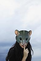 lady with mask, one finger on lips - Yukmin