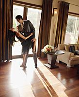 couple dancing at home - Alex Mares-Manton