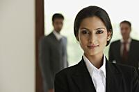 business woman, businessmen in background - Alex Mares-Manton