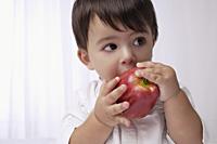 baby boy eating apple - Alex Mares-Manton