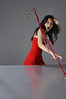 frustrated young lady in red, splashing wine on table - Yukmin