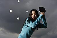 young lady hitting ping pong balls - Yukmin