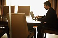 businessman working on laptop computer - Alex Mares-Manton