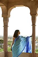 young woman in sari overlooking valley - Alex Mares-Manton
