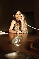 woman in sari on phone - Alex Mares-Manton