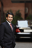 businessman in front of car - Alex Mares-Manton