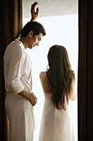 couple in front of bedroom window - Alex Mares-Manton