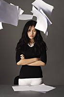 young lady standing, paper falling from above - Yukmin