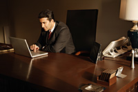 businessman on laptop computer - Alex Mares-Manton