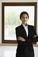 Businesswoman standing in front of window - Alex Mares-Manton