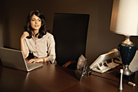 businesswoman working at laptop computer - Alex Mares-Manton