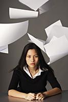 young lady sitting, paper falling - Yukmin