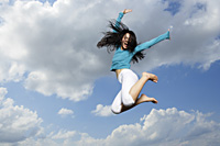 young lady jumping in midair - Yukmin