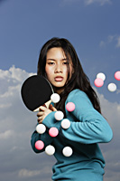 young lady ready to hit ping pong balls - Yukmin