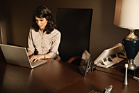 businesswoman working at laptop computer - Alex Mares-Manton