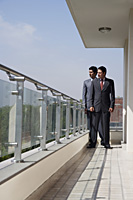 businessmen on balcony - Alex Mares-Manton