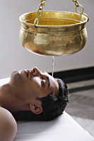 young man having Ayurvedic spa treatment - Alex Mares-Manton