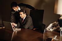 business associates at laptop computer - Alex Mares-Manton