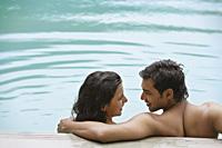 young couple in pool - Alex Mares-Manton